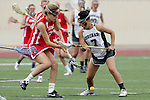 San Diego, CA 05/21/11 - Michaela Guerrera (Coronado #7) and Krystyn Berretta (Cathedral Catholic #3) in action during the 2011 CIF San Diego Division 2 Girls lacrosse finals between Cathedral Catholic and Coronado.