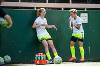 Seattle, WA - Sunday, April 17, 2016: Seattle Reign FC forward Beverly Yanez (17) and Seattle Reign FC midfielder Jessica Fishlock (10) enjoying pregame warm-ups together.  Sky Blue FC defeated the Seattle Reign FC 2-1 during a National Women's Soccer League (NWSL) match at Memorial Stadium.