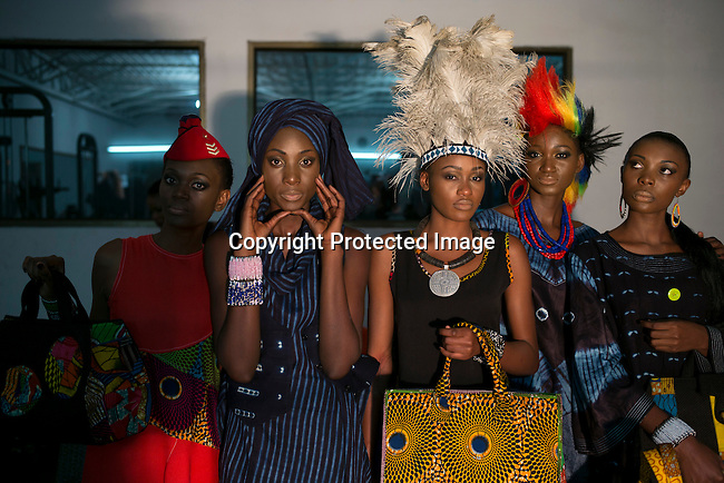 KINSHASA, DRC - JULY 24: Models wait backstage before a show with label 6KASSO at Kinshasa Fashion Week on July 24, 2015, at Shark club in Kinshasa, DRC. Local and invited foreign-based designers showed their collections during the yearly Kinshasa Fashion week. (Photo by Per-Anders Pettersson)