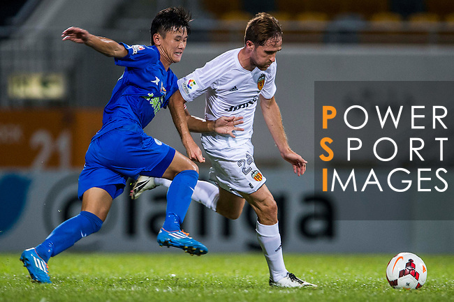 (R) Michel Herrero of Valencia CF competes for the ball with (L) during LFP World Challenge 2014 between Valencia CF vs BC Rangers FC on May 28, 2014 at the Mongkok Stadium in Hong Kong, China. Photo by Victor Fraile / Power Sport Images