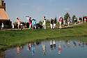 Players leave the 18th green during the third round of the Kazakhstan Open played at Zhailjau Golf Resort, Almaty on September 15, 2012 in Almaty, Kazakhstan.(Picture Credit / Phil Inglis)