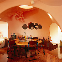 The small dining alcove tucked off the main living area has a fresco on the domed ceiling