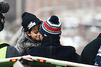 February 4, 2015 - Boston, Massachusetts, U.S. - New England Patriots quarterback Tom Brady (12) shares a moment with son Benjamin during a parade held in Boston to celebrate the team's victory over the Seattle Seahawks in Super Bowl XLIX. Eric Canha/CSM