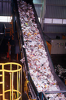 RECYCLING PLANT<br /> Sloatsburg, NY<br /> Conveyor belt with recycled material. Materials that can be recycled include metal, plastic, paper, and glass.