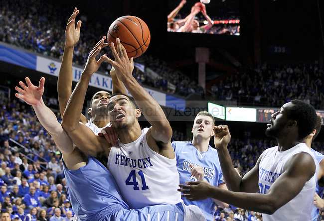 Kentucky forward Trey Lyles fights for a loose ball during the first half of the UK men's basketball game vs. Columbia at Rupp Arena in Lexington , Ky., on Wednesday, December 10, 2014. Photo by Jonathan Krueger | Staff