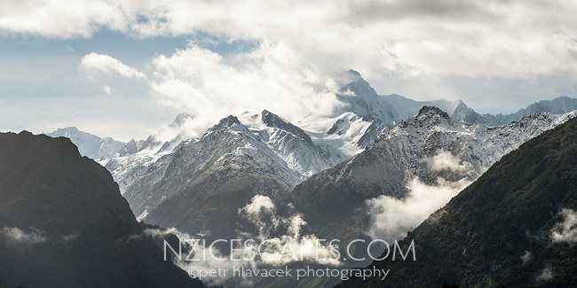 Winter scene of Southern Alps after fresh snowfall with Fox Ridge in centre and Mount Tasman in clouds, Westland Tai Poutini National Park, UNESCO World Heritage Area, West Coast, New Zealand, NZ