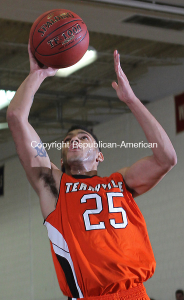 Woodbury, CT121812MK02 ACTIONMAN Terryville's Arthur Trent (25) scores against Nonnewaug during Berkshire League action Tuesday night at Nonnewaug High School in Woodbury. Terryville defeated Nonnewaug 60-40. Michael Kabelka / Republican-American