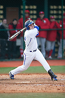 Kyle Grimm (7) of the Seton Hall Pirates follows through on his swing against the Cornell Big Red at The Ripken Experience on February 27, 2015 in Myrtle Beach, South Carolina.  The Pirates defeated the Big Red 3-0.  (Brian Westerholt/Four Seam Images)