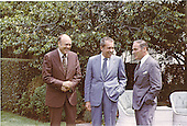 Washington, D.C. - July 7, 1973 -- White House Chief of Staff General Alexander M. Haig, Jr., right, shares some thoughts with United States President Richard M. Nixon ,center, and Melvin Laird, Counselor to the President for Domestic Affairs, left, in the Rose Garden at the White House in Washington, D.C. on July 7, 1973..Credit: White House / CNP