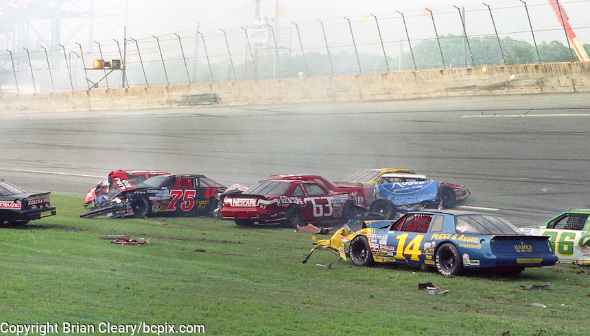 The cars of  Brad Teague (75), Chuck Bown (63), and Jack Sprague (14) are among the cars involved in one of the biggest crashes in the history of Daytona Internationa Speedway , a 24 car accident during the Goody's 300, NASCAR Busch Series, Daytona Beach, FL, February 17, 1990.  (Photo by Brian Cleary/www.bcpix.com)