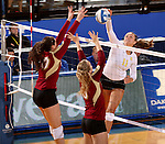 BROOKINGS, SD - OCTOBER 3:  Moni Corrujedo #10 and Sarah Schmid #3 from Denver look to block a kill attempt by Wagner Larson #11 from South Dakota State University in the first game of their match Friday night at Frost Arena. (Photo/Dave Eggen/Inertia)