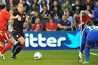 USWNT midfielder Lauren Cheney (12) moves in on the Canada goal.