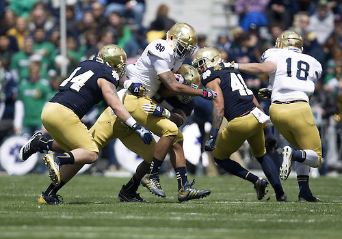 April 20, 2013: Notre Dame Fighting Irish running back George Atkinson III (4) as Notre Dame Fighting Irish outside linebacker Prince Shembo (55) makes the tackle during the Notre Dame Blue-Gold Spring game at Notre Dame Stadium in South Bend, Indiana.  The Defense topped the Offense by a score of 54-43.