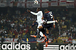 12 JUN 2010:  Emile Heskey (ENG)(21) and Oguchi Onyewu (USA)(5) compete for a head ball.  The England National Team played the United States National Team played to a 1-1 tie at Royal Bafokeng Stadium in Rustenburg, South Africa in a 2010 FIFA World Cup Group C match.