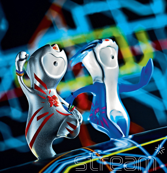 Wenlock and Mandeville, the London 2012 Olympic mascots, dance on a black, stripey background.