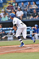 Asheville Tourists right fielder Yonathan Daza (2) swings at a pitch during a game against the Lexington Legends at McCormick Field on April 19, 2016 in Asheville, North Carolina. The Legends defeated the Tourists 11-9. (Tony Farlow/Four Seam Images)