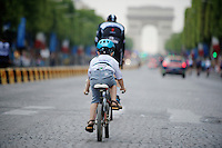 Most endearing moment on the Champs-Elys&eacute;es parade of the teams (after the winners ceremony): Niki Terpstra (NLD/OmegaPharma-Quickstep) followed by his 5yr old son Luca. In the white jersey...<br /> <br /> 2014 Tour de France<br /> stage 21: Evry - Paris Champs-Elys&eacute;es (137km)