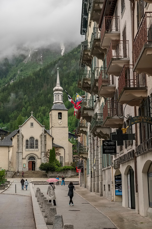 Saint Michel church hugs the forested lower slopes of the French Alps in Chamonix.