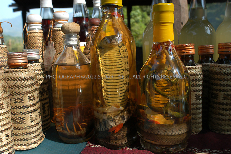 5/1/2003--Luang Prabang, Laos..Snake wine for sale along the banks of the Mekong River in Luang Prabang, also known as Louangphrabang, situated in northern Laos. It is the capital of Louangphrabang Province. ..Luang Prabang is the ancient capital city of the Lan Xang Kingdom...All photographs ©2003 Stuart Isett.All rights reserved.This image may not be reproduced without expressed written permission from Stuart Isett.