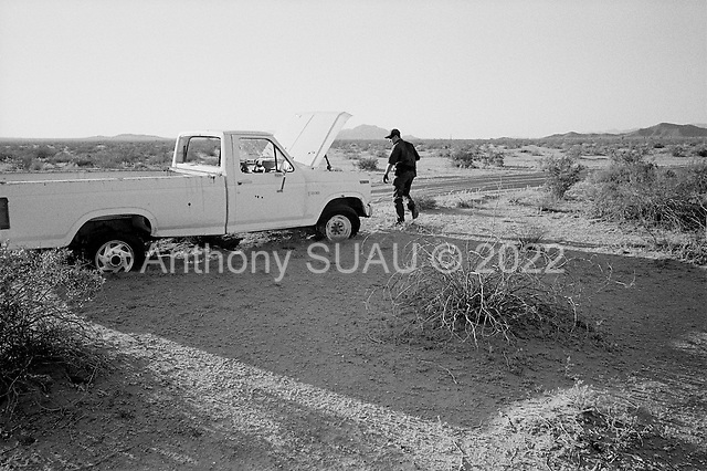 Cabeza Prieta National Wildlife Refuge, Arizona<br /> May 1, 2008<br /> <br /> US Border Patrol Agents inspect a vehicle stuck in the desert, most likely from illegal Mexican drug runners. There are hundreds of such vehicles throughout the Wildlife Refuge. ..Since US contractors have placed vehicle barrier along the Cabeza Prieta National Wildlife Refuge on the US/Mexican border  illegal crossings have been cut substantially in the past 6 months. Many illegal crossings have been pushed eastward to the Tucson sector.