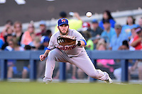 Midland RockHounds third baseman Max Muncy (9) waits for a throw during a game against the Tulsa Drillers on May 31, 2014 at ONEOK Field in Tulsa, Oklahoma.  Tulsa defeated Midland 5-3.  (Mike Janes/Four Seam Images)