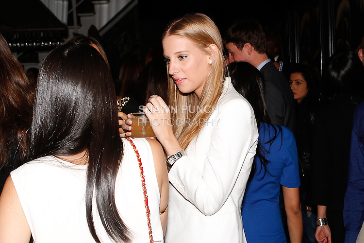 Guests attend the Laura Vela Spring 2014 handbag preview installation at No. 8 in New York City on September 17, 2013.