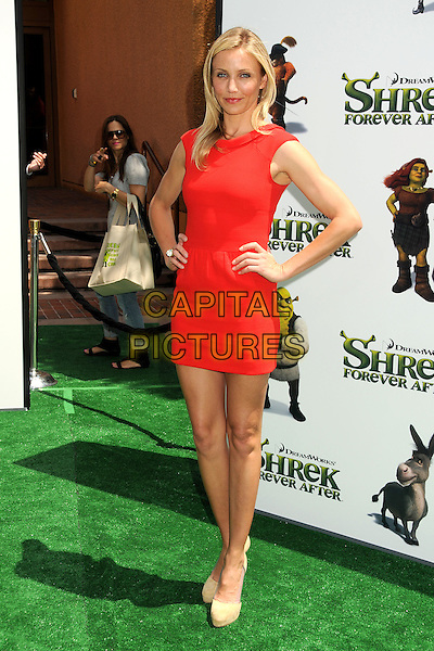 "CAMERON DIAZ.Attending the ""Shrek Forever After"" Los Angeles Film Premiere held at the Gibson Amphitheatre, Universal City, California, USA, 16th May 2010..arrivals full length red dress mini sleeveless beige nude platform shoes hands on hips ring .CAP/ADM/BP.©Byron Purvis/AdMedia/Capital Pictures."