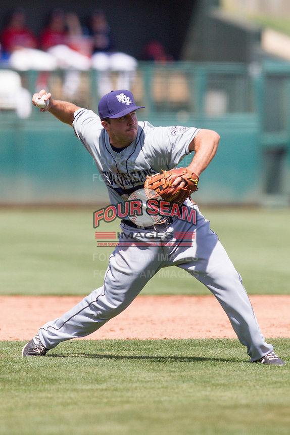 New Orleans Zephyrs third baseman Zack Cox (22) throws to first base during the Pacific League game at the Chickasaw Bricktown Ballpark against the Oklahoma City RedHawks on April 13, 2014 in Oklahoma City, Oklahoma.  The RedHawks defeated the Zephyrs 4-3.  (William Purnell/Four Seam Images)