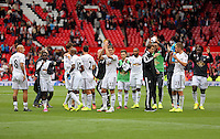 Pictured: Swansea players thank supporters after the final whistle. Saturday 16 August 2014<br />