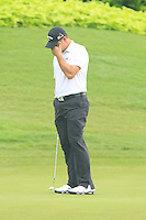 Gary Woodland (USA) on the 4th green during Round 3 of the CIMB Classic in the Kuala Lumpur Golf & Country Club on Saturday 1st November 2014.<br /> Picture:  Thos Caffrey / www.golffile.ie