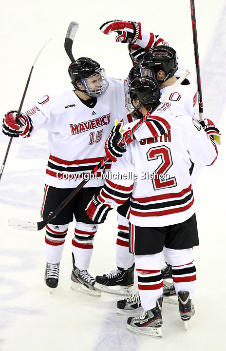 Nebraska-Omaha's Josh Archibald (15) and Matt Smith (2) celebrate Andrej Sustr's goal during the second period of Saturday's game against Alaska-Anchorage. (Photo by Michelle Bishop) .
