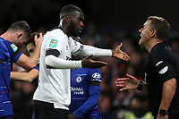 Fikayo Tomori of Derby, on loan from Chelsea, complains to the assistant referee as Cesc Fabregas celebrates scoring Chelsea's third goal in the background during Chelsea vs Derby County, Caraboa Cup Football at Stamford Bridge on 31st October 2018