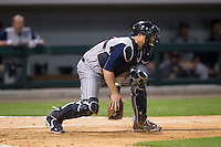 Toledo Mud Hens catcher Bryan Holaday (16) fields a throw at home plate during the game against the Charlotte Knights at BB&T BallPark on April 27, 2015 in Charlotte, North Carolina.  The Knights defeated the Mud Hens 7-6 in 10 innings.   (Brian Westerholt/Four Seam Images)