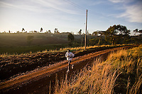A Kenyan athelete training, in April of 2009, on the road near Iten, a high altitude training area in western Kenya..The area, near Eldoret, is home to many world class marathon runners.