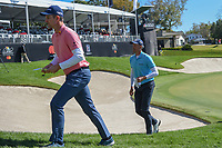Justin Rose (ENG) and Henrik Stenson (SWE) depart 18 during round 1 of the Arnold Palmer Invitational at Bay Hill Golf Club, Bay Hill, Florida. 3/7/2019.<br />