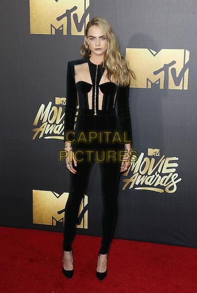BURBANK, CA - APRIL 09: Model Cara Delevingne attends the 2016 MTV Movie Awards at Warner Bros. Studios on April 9, 2016 in Burbank, California.<br /> CAP/ROT/TM<br /> &copy;TM/ROT/Capital Pictures