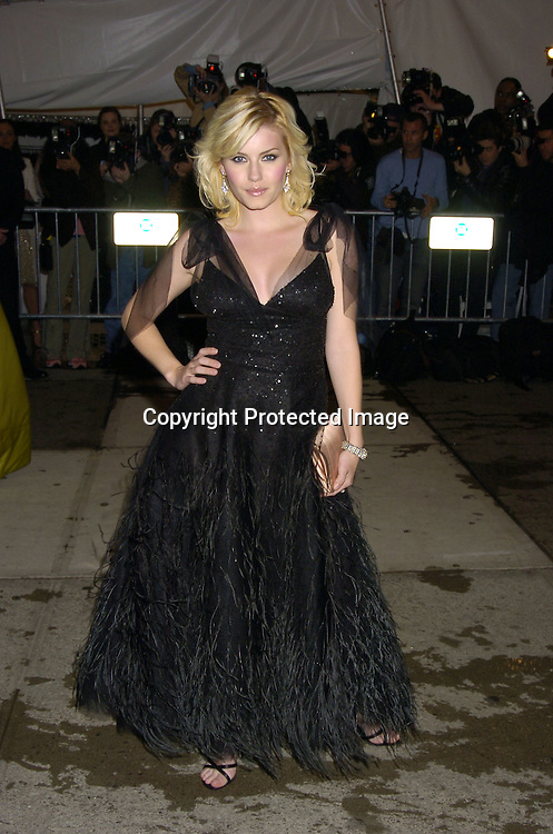 Elisha Cuthbert ..at The Metropolitan Museum of Art's Costume Institute Gala ..celebrating Chanel on May 2, 2005 in New York City.    Photo by Robin Platzer, Twin Images