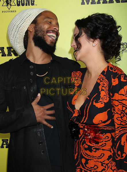 Ziggy Marley, Orly Aqal.'Marley' Los Angeles Premiere held at Arclight Cinemas, Hollywood, California, USA..April 17th, 2012.half length jacket red print dress married husband wife beige black white crochet hat beard facial hair hand smiling profile .CAP/ADM/RE.©Russ Elliot/AdMedia/Capital Pictures.