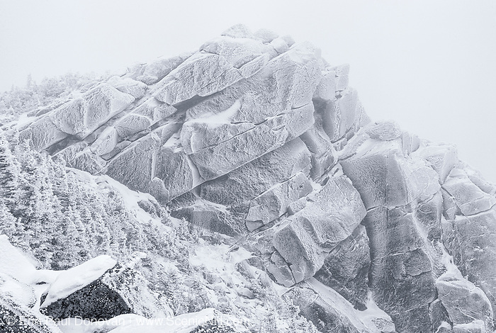 Black & white scene of whiteout conditions on the summit of Mount Liberty in the New Hampshire White Mountains during the winter months.