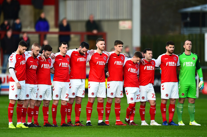 The Fleetwood Town players acknowledge a minutes silence for former Fleetwood player Jim Strachan<br /> <br /> Photographer Richard Martin-Roberts/CameraSport<br /> <br /> The EFL Sky Bet League One - Fleetwood Town v Portsmouth - Saturday 29th December 2018 - Highbury Stadium - Fleetwood<br /> <br /> World Copyright © 2018 CameraSport. All rights reserved. 43 Linden Ave. Countesthorpe. Leicester. England. LE8 5PG - Tel: +44 (0) 116 277 4147 - admin@camerasport.com - www.camerasport.com