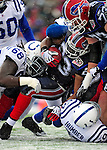 3 January 2010: Buffalo Bills' running back Marshawn Lynch is tackled by Indianapolis Colts defensive tackle Eric Foster (68) during a cold, snowy, final game of the season at Ralph Wilson Stadium in Orchard Park, New York. The Bills defeated the Colts 30-7. Mandatory Credit: Ed Wolfstein Photo