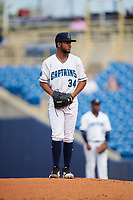 Lake County Captains starting pitcher Gregori Vasquez (34) gets ready to deliver a pitch during the first game of a doubleheader against the South Bend Cubs on May 16, 2018 at Classic Park in Eastlake, Ohio.  South Bend defeated Lake County 6-4 in twelve innings.  (Mike Janes/Four Seam Images)