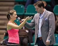 14-12-12, Rotterdam, Tennis Masters 2012, Quirine Lemoine  word op de ban geintervieuwd door  Alex Nelissen.