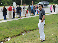 NWA Democrat-Gazette/ANDY SHUPE<br /> Ewald Ulmer of Sioux Falls, S.D., is moved to tears Saturday, Aug. 22, 2015, as he prays near a line of nearly 200 people gathered to protest in front of the Planned Parenthood office 3729 N Crossover Road in Fayetteville. The protest was a part of a national effort to call for the defunding of the organization.