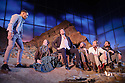 London, UK. 24.02.2015. MAN AND SUPERMAN, directed by Simon Godwin, opens in the Lyttelton, at the National Theatre. Picture shows: Elliot Barnes-Worrell (Straker), Naomi Cranston (The Sulky Social Democrat), Tim McMullan (Mendoza), Colin Haigh (The Anarchist), Arthur Wilson (The Rowdy Social Democrat), Ralph Fiennes (Jack Tanner) and Nicholas Bishop (The Frenchman). Photograph © Jane Hobson.