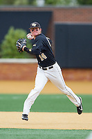 Conor Keniry (14) of the Wake Forest Demon Deacons makes a throw to first base against the Florida State Seminoles at Wake Forest Baseball Park on April 19, 2014 in Winston-Salem, North Carolina.  The Seminoles defeated the Demon Deacons 4-3 in 13 innings.  (Brian Westerholt/Four Seam Images)