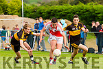 gavin O'Shea and Brian Looney Dr Crokes and Brendan kellliher Dingle in action at the club championship final in Milltown on Sunday