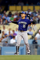 Carlos Gonzalez #5 of the Colorado Rockies bats against the Los Angeles Dodgers at Dodger Stadium on April 30, 2013 in Los Angeles, California. (Larry Goren/Four Seam Images)