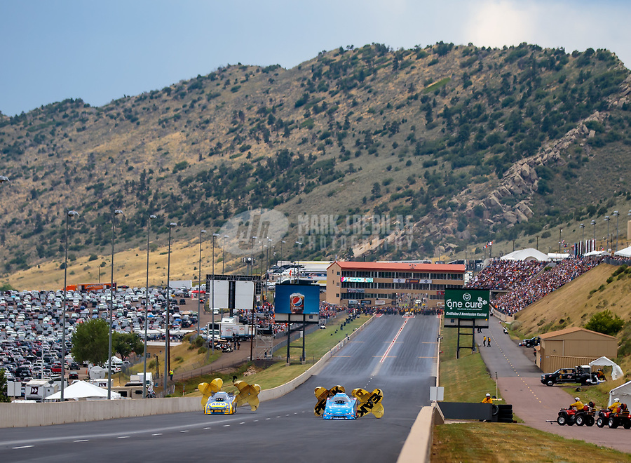 Jul 22, 2018; Morrison, CO, USA; NHRA funny car driver John Force (right) defeats Ron Capps to win the Mile High Nationals at Bandimere Speedway. Mandatory Credit: Mark J. Rebilas-USA TODAY Sports