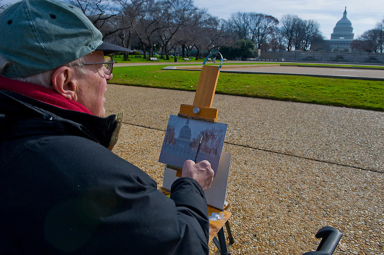 Artist Denny Lubecke of Illinois paints the U.S. Capitol from the Upper Senate Park on December 14, 2009.